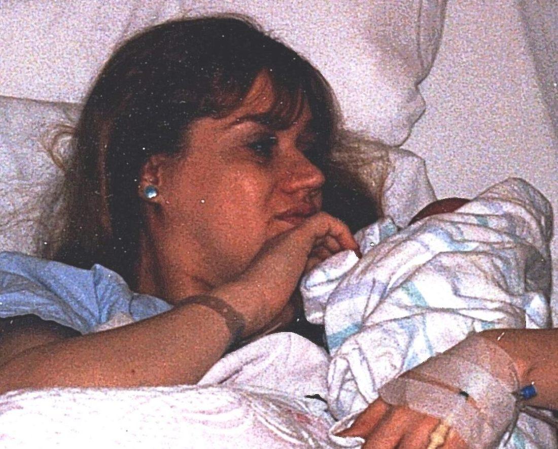 Hoding newborn Amanda